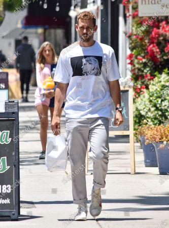 Nick Viall is seen wearing a Kurt Cobain shirt