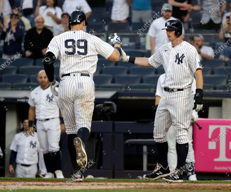 New York Yankees right fielder Aaron Judge (L) celebrates his two run home run at home plate with teammate New York Yankees first baseman DJ LeMahieu (R) during game two of a double header against the Toronto Blue Jays in the third inning of their MLB game at Yankee Stadium in the Bronx, New York, USA, 27 May 2021. The game was postponed to inclement weather on 26 May.