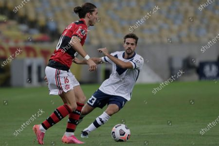 Stock Image of Agustin Bouzat of Argentina's Velez Sarsfield, right, and Filipe Luis of Brazil's Flamengo battle for the ball during a Copa Libertadores soccer match in Rio de Janeiro, Brazil