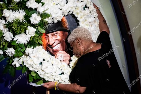 US comedian Luenell hugs a portrait of Paul Mooney surrounded by white flowers in the shape of a heart before she takes the stage and speaks to friends, family and colleagues during the tribute to comedian Paul Mooney at the Laugh Factory in Los Angeles, California, USA, 27 May 2021. Paul Mooney died from a heart attack at his home in Oakland, California on 19 May at the age of 79.