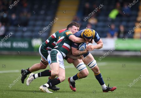 Matt Scott and Jasper Wiese of Leicester Tigers tackle Justin Clegg of Worcester Warriors; Sixways Stadium, Worcester, Worcestershire, England; Premiership Rugby, Worcester Warriors versus Leicester Tigers.