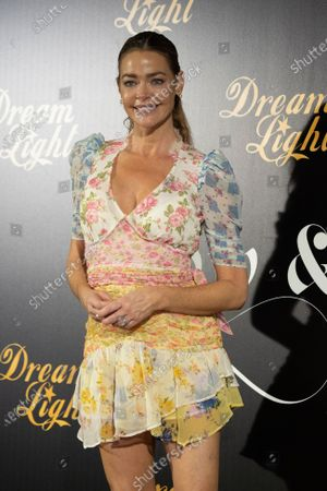 Actress Denise Richards attends ''Glow & Darkness'' photocall at the Palace Hotel on October 26, 2020 in Madrid, Spain.