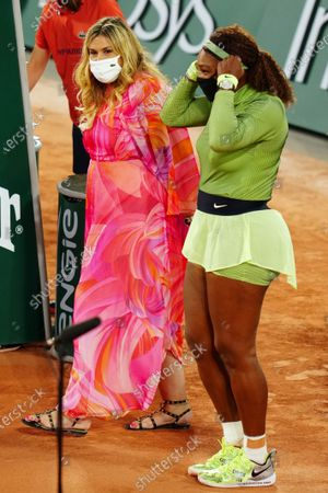 Serena Williams and Marion Bartoli after her first round match