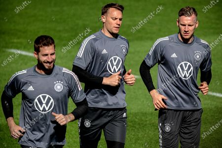 (L-R) Germany's goalkeepers Kevin Trapp, Manuel Neuer and Bernd Leno warm up for a training session in Seefeld, Austria, 28 May 2021. The German squad prepares for the upcoming UEFA EURO 2021 in Europe at a training camp in Seefeld until 06 June 2021.