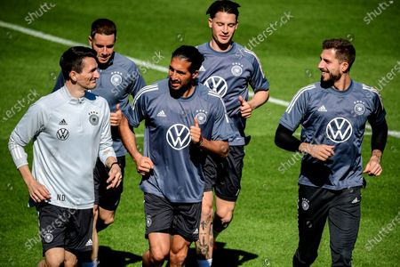 (R-L) Germany's goalkeeper Kevin Trapp, Robin Koch, Emre Can and Christian Guenter warm up for a training session in Seefeld, Austria, 28 May 2021. The German squad prepares for the upcoming UEFA EURO 2021 in Europe at a training camp in Seefeld until 06 June 2021.