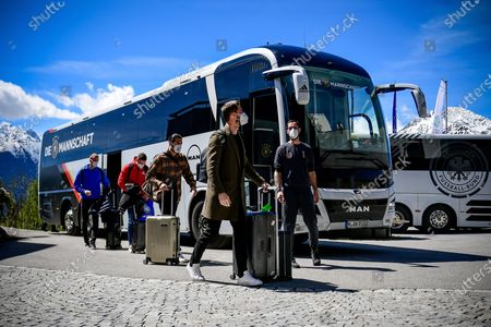Germany's goalkeeper Kevin Trapp (2-R), players Emre Can (C) and Robin Gosens (2-L) arrive at the team hotel in Seefeld, Austria, 28 May 2021. The German squad prepares for the upcoming UEFA EURO 2021 in Europe at a training camp in Seefeld until 06 June 2021.