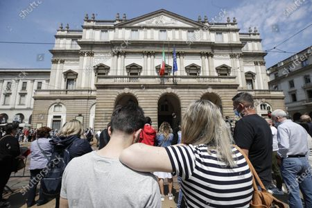 People gather to pay their last homage to Carla Fracci, outside La Scala opera house, in Milan, Italy, . Carla Fracci, an Italian cultural icon and former La Scala prima ballerina renowned for romantic roles alongside such greats as Rudolf Nureyev and Mikhail Baryshnikov, died Thursday at her home in Milan. She was 84