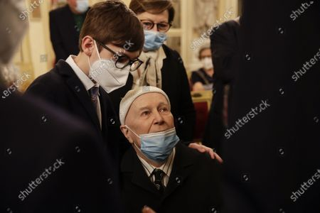 Beppe Menegatti, husband of Carla Fracci is comforted by his grandson Ariele, left, at La Scala opera house where Carla Fracci lies in state, in Milan, Italy, . Carla Fracci, an Italian cultural icon and former La Scala prima ballerina renowned for romantic roles alongside such greats as Rudolf Nureyev and Mikhail Baryshnikov, died Thursday at her home in Milan. She was 84