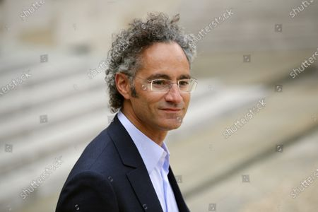 """Alexander Karp, US co-founder and CEO of the software firm Palantir Technologies leaves after the """"Tech for Good"""" Summit at the Elysee Palace in Paris. Pay packages rose yet again in 2020 for the CEOs of the biggest U.S. companies, even though the pandemic sent the economy to its worst quarter on record and slashed corporate profits around the world"""