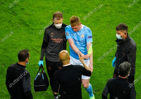 Stock Photo of Kevin De Bruyne of Manchester City is visibly upset as he goes off with a head injury with Manchester City Manager Pep Guardiola