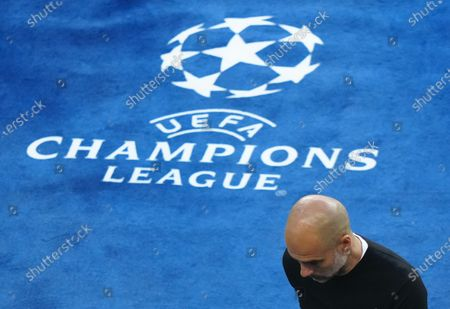 Manchester City Manager Pep Guardiola  looking dejected