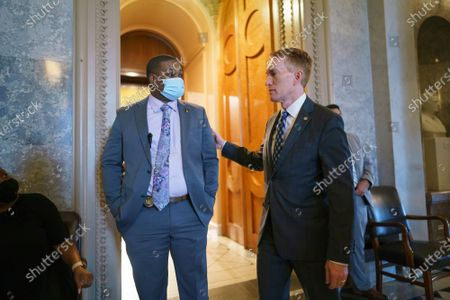 Sen. James Lankford, R-Okla., right, greets U.S. Capitol Police officer Eugene Goodman who diverted the rioters from the Senate chamber during the Jan. 6 storming of the Capitol, following the vote on the creation of a commission to study the insurrection by rioters loyal to former President Donald Trump, at the Capitol in Washington, . Sen. Lankford voted with the Republican leadership to block the measure