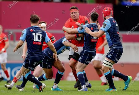 Munster vs Cardiff Blues. Munster's CJ Stander is tackled by Ben Thomas and Tomos Williams of Cardiff