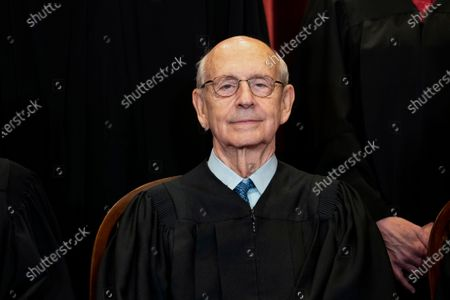 Stock Photo of Supreme Court Associate Justice Stephen Breyer sits during a group photo at the Supreme Court in Washington. Breyer is talking with the head of the National Constitution Center in Philadelphia and taking questions from students on Friday, May 28