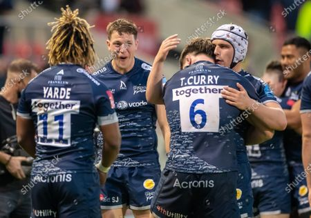 Tom Curry (C) of Sale Sharks celebrates with Curtis Langdon, Marland Yarde and an extatic Sam James of Sale Sharks after their 22-12 win; AJ Bell Stadium, Salford, Lancashire, England; English Premiership Rugby, Sale Sharks versus Bristol Bears.