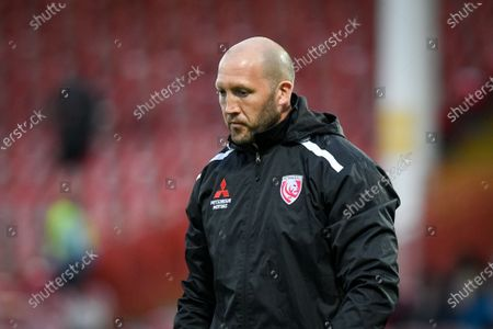 Gloucester Rugby Head Coach George Skivington watches over warm ups