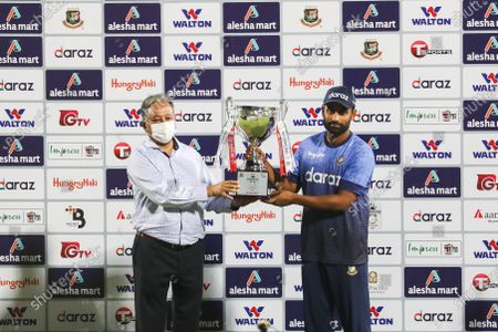 Bangladesh's captain Tamim Iqbal and BCB president Nazmul Hassan Papon holds the tournament trophy after the third and final one-day international (ODI) cricket match between Bangladesh and Sri Lanka at Sher-e-Bangla National Cricket Stadium in Dhaka on May 28, 2021.