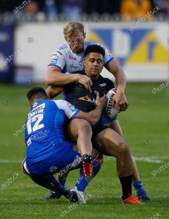 Castleford Tigers' Derrell Olpherts in action with Leeds Rhinos' Matt Prior and Rhyse Martin
