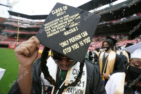 Stock Image of Graduating senior Ravon Cooper from Carnahan High School displays a Malcolm X quote on his cap during commencement ceremonies for six St. Louis high schools at Busch Stadium in St. Louis on Friday, May 28, 2021. Over 600 seniors participated in the graduation ceremonies.