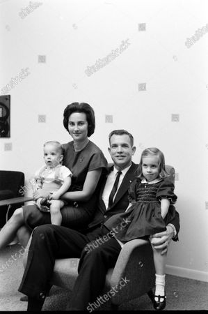 Astronaut David Scott sitting chair with his family in the United States, October 1964