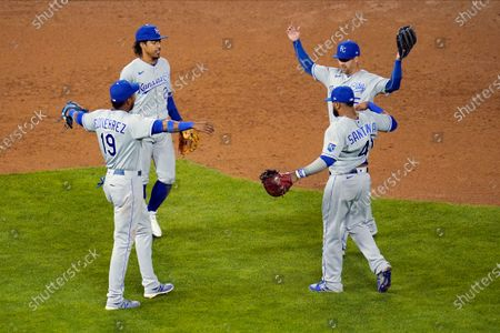 Kansas City Royals players Kelvin Gutierrez (19), Michael A. Taylor (2), Carlos Santana (41) and Whit Merrifield celebrate a win over the Minnesota Twins in a baseball game, in Minneapolis