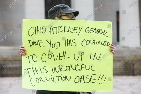Stock Image of Black Lives Matter advocate holds a sign condemning Ohio Attorney General David Yost for not releasing DeWitt McDonald Jr. sooner during the demonstration.Family members of DeWitt McDonald Jr. and Black Lives Matter advocates demonstrate on the north side of the Ohio Statehouse, which faces the building that houses the Ohio Attorney General to ask for the acquittal and release of McDonald from prison.