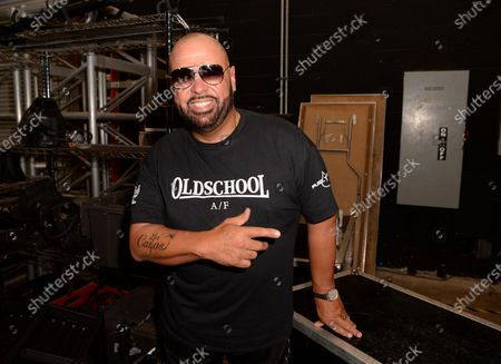 Stock Picture of DJ Laz poses backstage