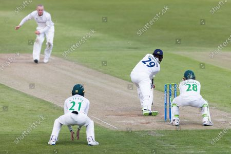 Callum Parkinson bowls to Peter Handscomb with Sam Evans at leg slip during Day 3 of the LV= Insurance County Championship match between Leicestershire County Cricket Club and Middlesex County Cricket Club at the Uptonsteel County Ground, Leicester