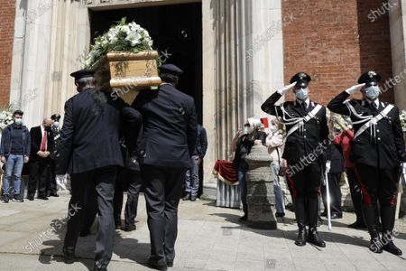 The coffin of Carla Fracci is shoulder carried inside the San Marco church for the funeral service in Milan, Italy, . Carla Fracci, an Italian cultural icon and former La Scala prima ballerina renowned for romantic roles alongside such greats as Rudolf Nureyev and Mikhail Baryshnikov, died Thursday at her home in Milan. She was 84