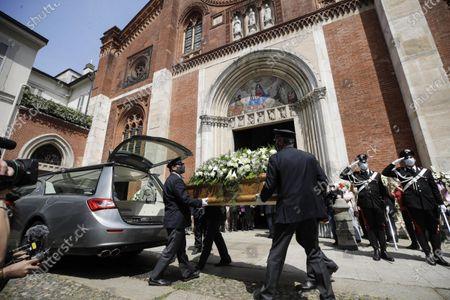 The coffin of Carla Fracci is carried inside the San Marco church for the funeral service in Milan, Italy, . Carla Fracci, an Italian cultural icon and former La Scala prima ballerina renowned for romantic roles alongside such greats as Rudolf Nureyev and Mikhail Baryshnikov, died Thursday at her home in Milan. She was 84
