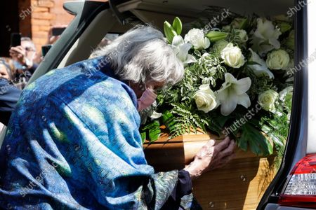 Woman hugs the coffin of Carla Fracci after the funeral service, at the San Marco church, in Milan, Italy, . Carla Fracci, an Italian cultural icon and former La Scala prima ballerina renowned for romantic roles alongside such greats as Rudolf Nureyev and Mikhail Baryshnikov, died Thursday at her home in Milan. She was 84