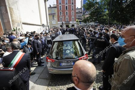 People gather to pay their last homage to Carla Fracci, after the funeral service at the San Marco church, in Milan, Italy, . Carla Fracci, an Italian cultural icon and former La Scala prima ballerina renowned for romantic roles alongside such greats as Rudolf Nureyev and Mikhail Baryshnikov, died Thursday at her home in Milan. She was 84