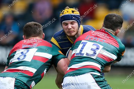 Justin Clegg of Worcester Warriors takes on Jasper Wiese and Matt Scott of Leicester Tigers