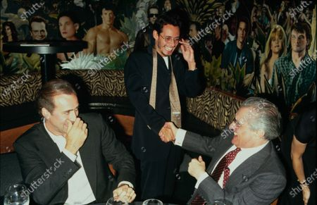 Stock Photo of UNITED STATES - circa 1999: Actor Nicolas Cage and singer Marc Anthony with director Martin Scorsese at Planet Hollywood. They all worked on the film 'Bringing out the Dead'.
