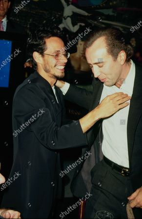 Stock Picture of UNITED STATES - circa 1999: Actor Nicolas Cage and singer Marc Anthony.