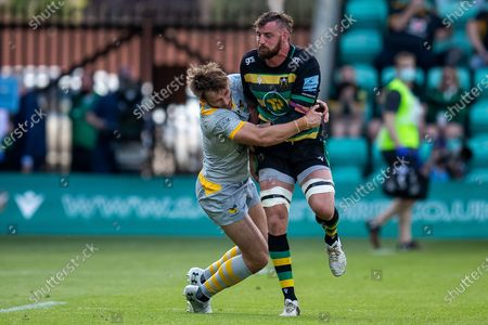 Tom Wood of Northampton Saints tackled during the Gallagher Premiership Rugby match between Northampton Saints and Wasps at Franklins Gardens, Northampton