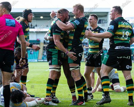 Tom Wood of Northampton Saints celebrates scoring a try
