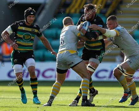 Stock Picture of Tom Wood of Northampton Saints runs into the challenge of   Tom Cruse of Wasps