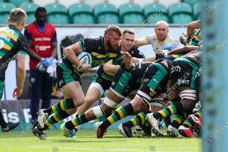 Tom Wood of Northampton Saints bursts out of defence