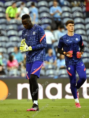 Chelsea's goalkeeper Edouard Mendy (L) warms up for the UEFA Champions League final between Manchester City and Chelsea FC in Porto, Portugal, 29 May 2021.