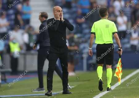 Manager Josep Guardiola of Manchester City reacts during the UEFA Champions League final between Manchester City and Chelsea FC in Porto, Portugal, 29 May 2021.