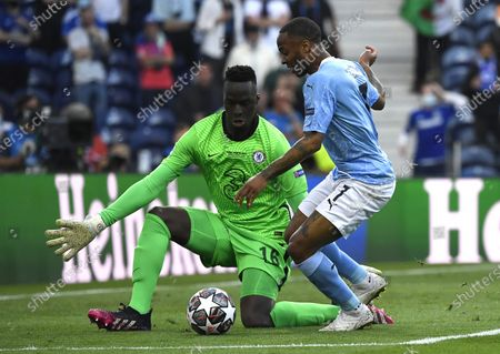 Raheem Sterling (R) of Manchester City in action against Chelsea's goalkeeper Edouard Mendy (L) during the UEFA Champions League final between Manchester City and Chelsea FC in Porto, Portugal, 29 May 2021.