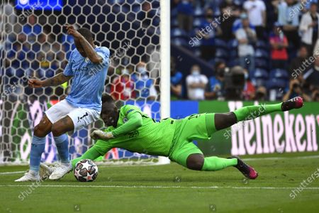 Raheem Sterling (L) of Manchester City in action against Chelsea's goalkeeper Edouard Mendy (R) during the UEFA Champions League final between Manchester City and Chelsea FC in Porto, Portugal, 29 May 2021.