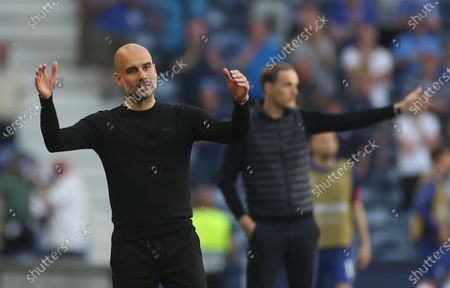 Manager Josep Guardiola (L) of Manchester City and Manager Thomas Tuchel of Chelsea react during the UEFA Champions League final between Manchester City and Chelsea FC in Porto, Portugal, 29 May 2021.