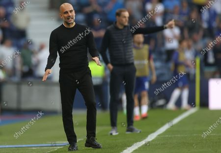 Stock Image of Manager Josep Guardiola (L) of Manchester City and Manager Thomas Tuchel of Chelsea react during the UEFA Champions League final between Manchester City and Chelsea FC in Porto, Portugal, 29 May 2021.