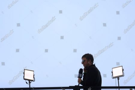 Noel Gallagher talks with a TV broadcast prior to the start of the Champions League final soccer match between Manchester City and Chelsea at the Dragao Stadium in Porto, Portugal