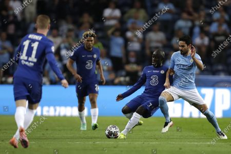 Manchester City's Ilkay Gundogan, right, is challenged by Chelsea's N'Golo Kante, second right, during the Champions League final soccer match between Manchester City and Chelsea at the Dragao Stadium in Porto, Portugal