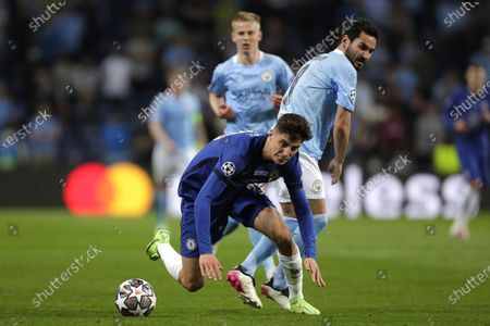 Chelsea's Kai Havertz, left, fights for the ball with Manchester City's Ilkay Gundogan during the Champions League final soccer match between Manchester City and Chelsea at the Dragao Stadium in Porto, Portugal