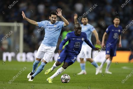 Chelsea's N'Golo Kante, right, runs with the ball past Manchester City's Ilkay Gundogan during the Champions League final soccer match between Manchester City and Chelsea at the Dragao Stadium in Porto, Portugal