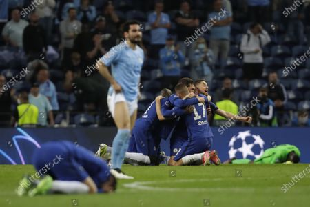 Manchester City's Ilkay Gundogan reactes as Chelsea players celebrate end of the Champions League final soccer match between Manchester City and Chelsea at the Dragao Stadium in Porto, Portugal